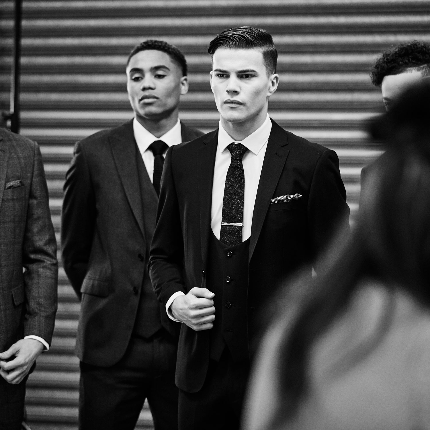 models in suits at a photography studio